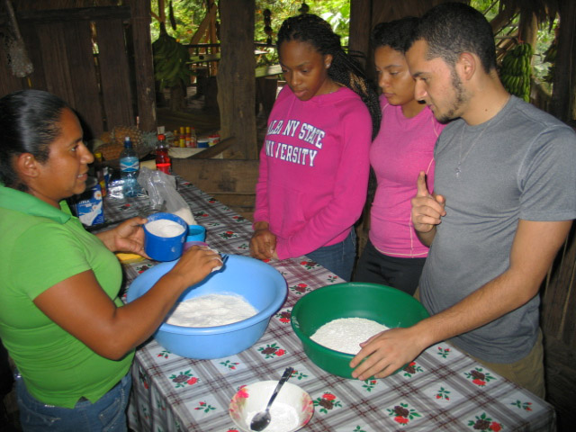Students learn how to make fried arepas.