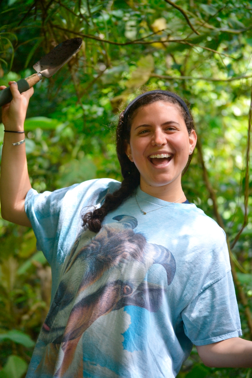 Adina Beiner is all smiles while planting seedlings as part of UGA Costa Rica's carbon offset program.