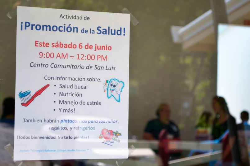 Signs like this advertised the event around the community, including on UGACR's campus.