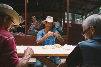 Men measure out string which was later used to wrap tamale leaves.