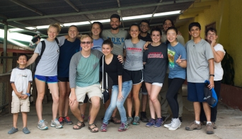 The University of Georgia Latin American & Caribbean Studies group poses for a group photo after helping San Luis locals in their preparations.